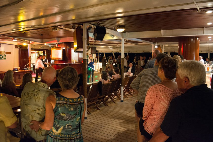The (guest) talent show on-deck at the Tropical Bar. Photo © 2015 Aaron Saunders
