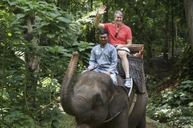 Riding elephants in Bali.