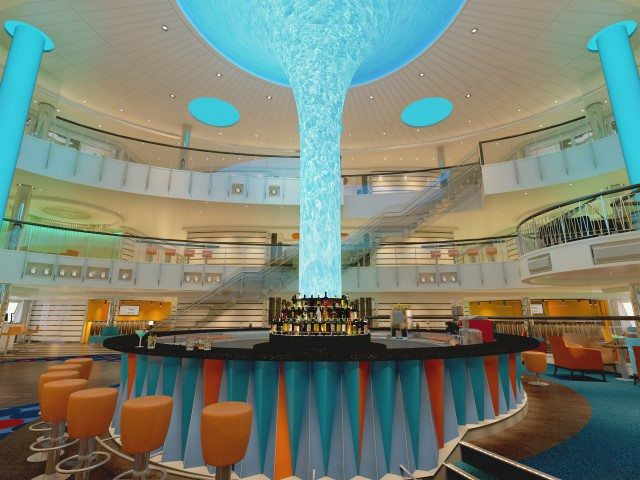 The redesigned Atrium concept aboard Carnival Vista provided the extra space needed to squeeze in the first IMAX Theatre at sea. Rendering courtesy of Carnival Cruise Lines.