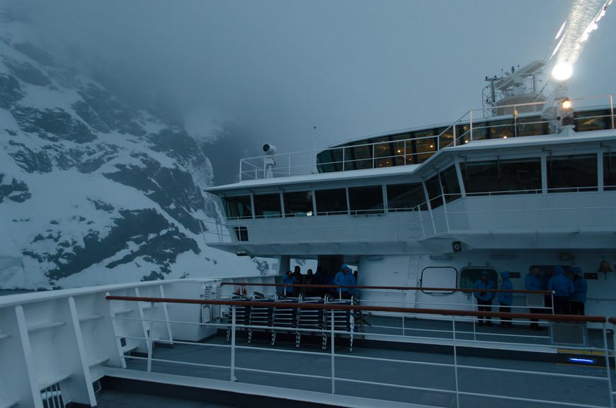 Hurtigruten's FRAM, transiting the Lemaire Channel in Antarctica on a snowy evening. Photo © 2015 Aaron Saunders