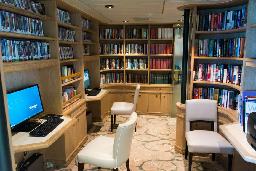 Tucked away on Deck 6 aft, starboard side, is a cozy and well-stocked library featuring books and DVD's for (free) rent. Photo © 2016 Aaron Saunders