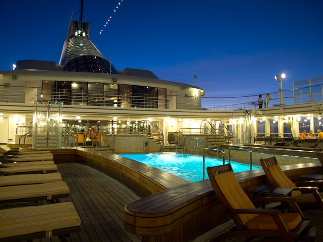 Silver Spirit's attractive Pool Deck, at night, facing aft. Photo © 2012 Aaron Saunders