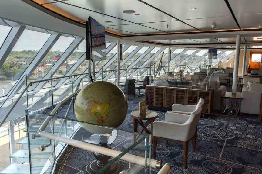 My Undisputed Favorite Place Onboard: the two-story Explorer's Lounge that pays homage to famed Norwegian Polar Explorer, Roald Amundsen. Photo © 2016 Aaron Saunders