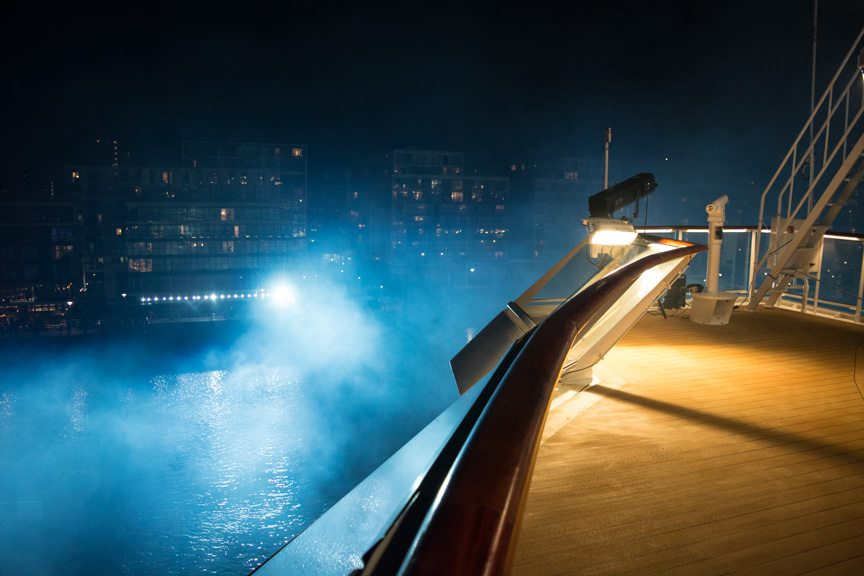 Fireworks smoke drifts past the starboard bridge wing overlook aboard Viking Sea as crowds on-shore cheer. Photo © 2016 Aaron Saunders