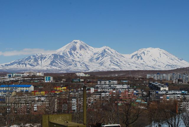 Avachinsky Volcano is the smaller of the two massive peaks behind Petropavlovsk