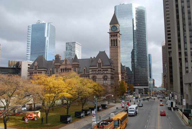 Looking east along Queen Street with the old City Hall tower and new high-rises in contrast